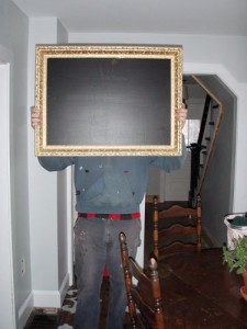 Colby Showing Off The Chalkboard Mirror