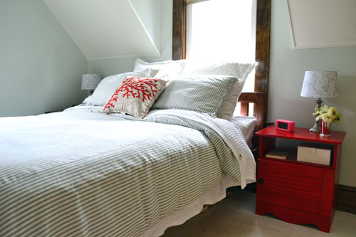 Master Bedroom With Red Nightstand