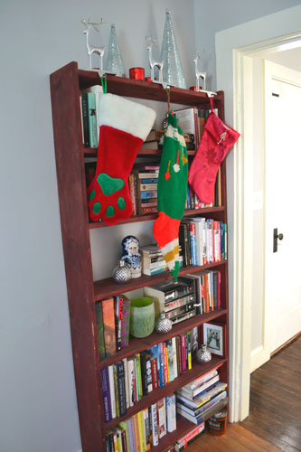 Bookcase Decorated For Christmas