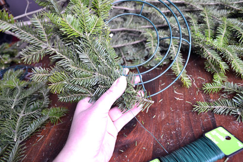 Adding Spruce Branches To Wreath Form