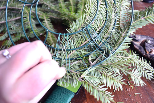 Using Floral Wire To Wrap Branches Around Wreath Form