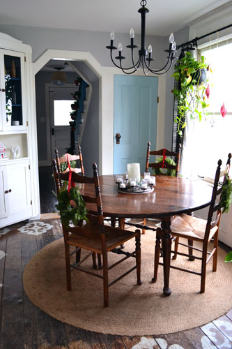Mini Wreaths On Backs Of Dining Room Chairs