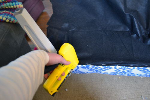 Stapling Black Breathable Fabric To Bottom Of Chair