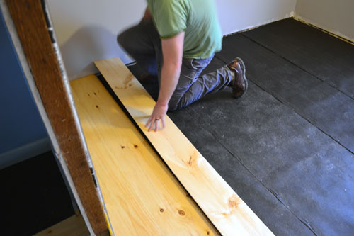 Laying Wide Pine Flooring In Guest Room