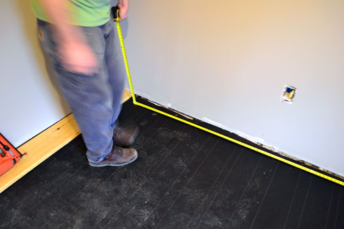 Measuring Room Before Laying Flooring
