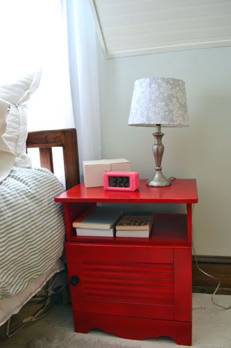 Red Night Stand With Old Lamp
