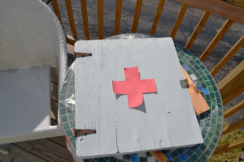 Testing Out First Aid Cross On Wall Cabinet