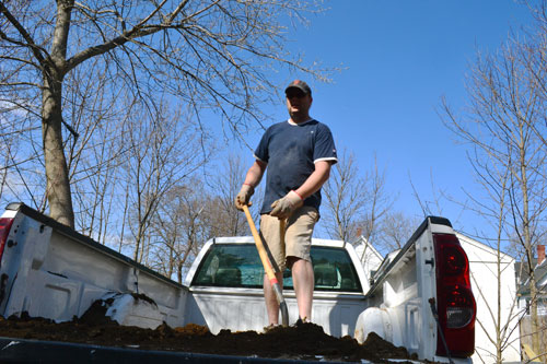 Shoveling Dirt Into Raised Beds
